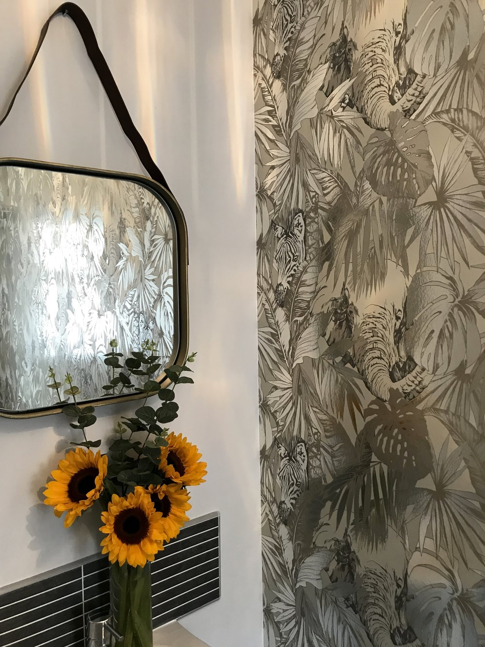 The brass framed mirror offsets the beautiful wallpaper perfectly in Beth's downstairs bathroom  Wallpaper- 'Maharaja'-   Prestigious.co.uk   ..... Mirror-   Next.co.uk