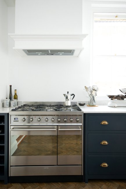 This Devol kitchen has mixed the metals beautifully, the brass handles sit next to the stainless steel range and accessories making them a real feature......