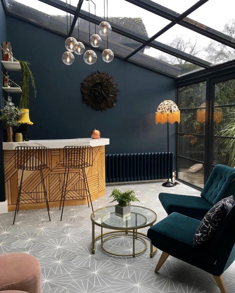 The hex dandelion tiles from   @marrakechdesign   are a real feature of the room......The ceiling light is from   @inscapedesign   ....... Lamp shade by Anna Hayman..... Bar stools & Coffee tables   @Rockettstgeorge.co.uk