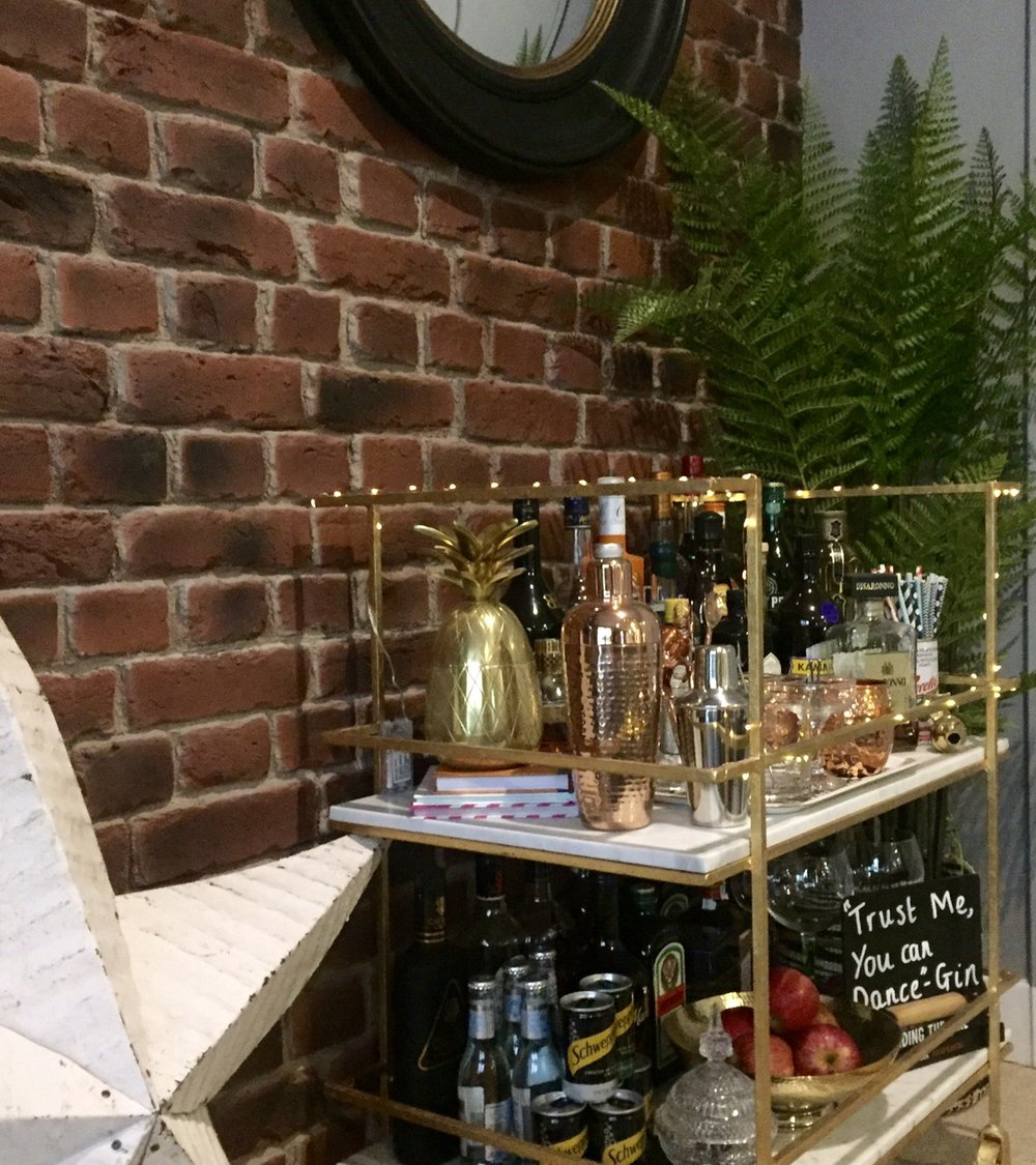 Jo's bar trolley is The Edina from   Swoon Editions.  ..... She keeps the fairy lights wrapped around it all year as well as making sure it's always well stocked obviously!     @outsidethebeigebox