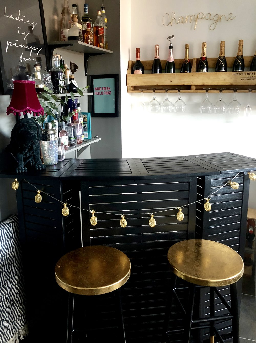 Beth's bar in the corner of her kitchen is from   Wayfair.co.uk,  she  painted it in Farrow & Ball 'Pitch Black' and added gold accents..... you can see more of Beth's home on her home tour   HERE      @bethshehata