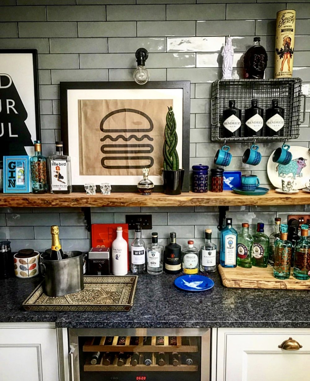 I love the bar area in Danny's kitchen...... He too loves a Gin shelf as you can see...... Add the fab prints, quirky accessories and bar fridge sitting underneath and this is just about a perfect kitchen bar station    @brooklands_23_