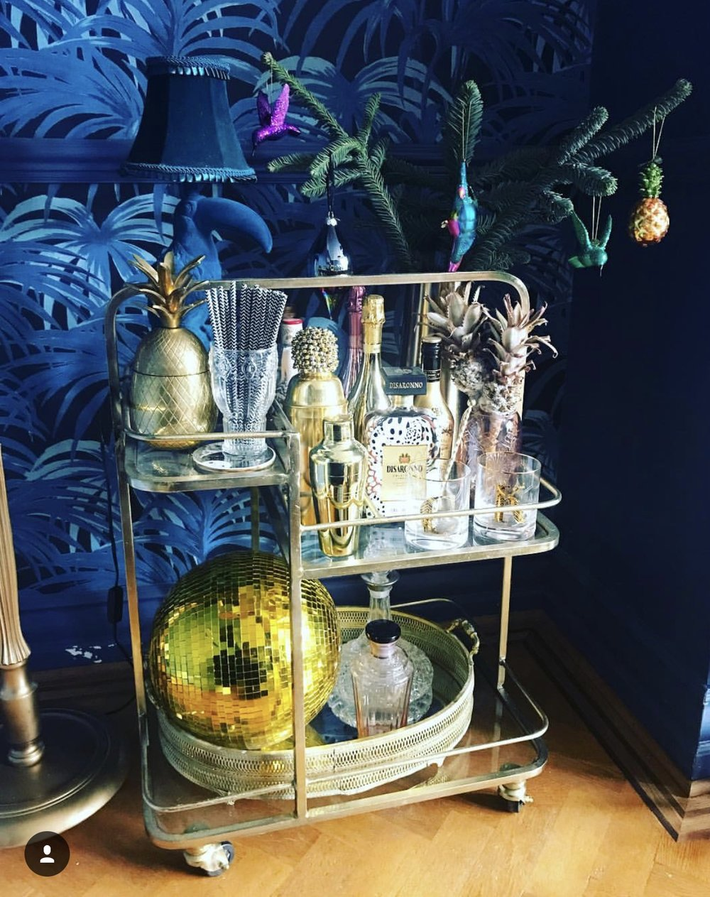 Katie Woods knows a thing or two about adding glamour to her home and this gold bar trolley  from   Aitken and Thyme   with the addition of the large gold glitter ball and accessories certainly adds wow factor to the corner of this room......    @comedowntothewoods