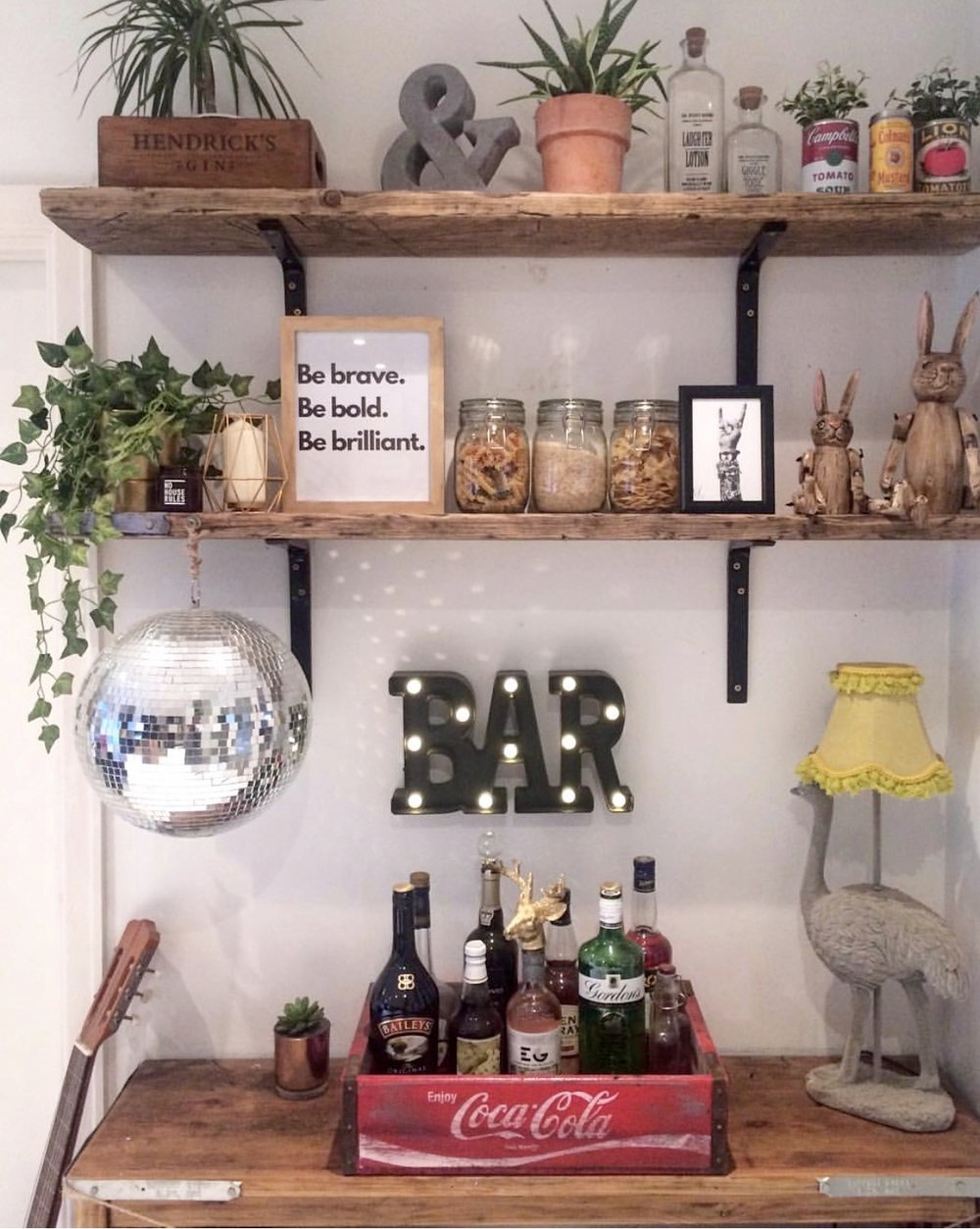 Angie has utilised a crate to make a lovely little bar area in her kitchen ......The addition of the glitter ball, bar sign and fabulously quirky emu lamp show that even in the smallest of spaces a cool home bar is achieveable!     @loves_leeds_homes
