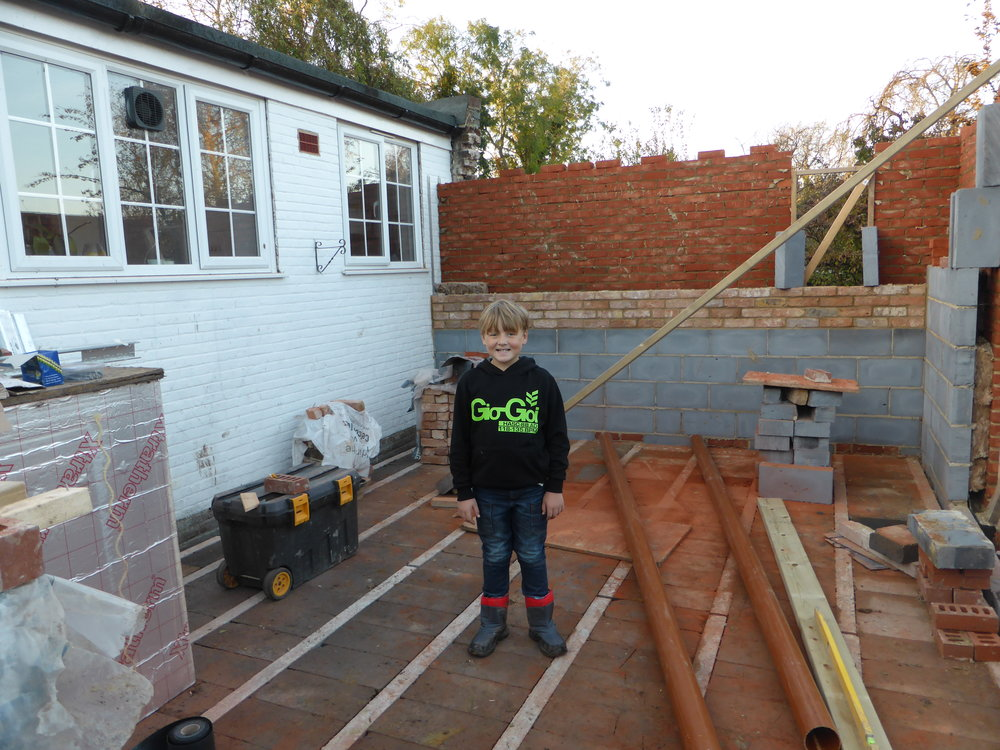 My boy inspecting the building site and the reclaimed brick internal wall going up.......