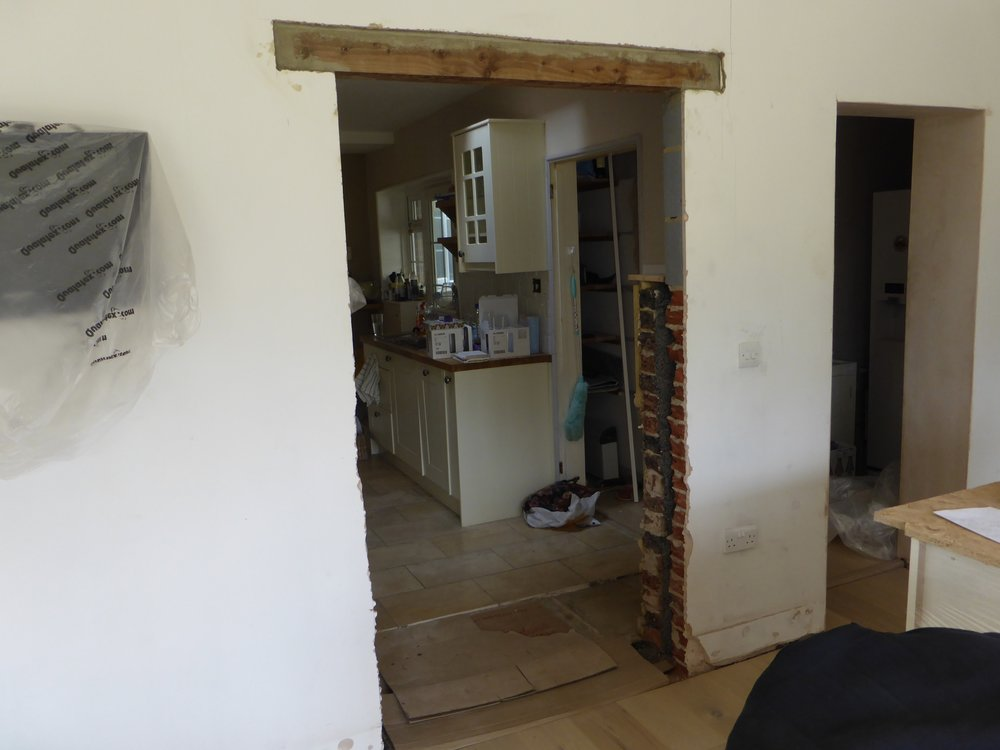 Knocking through into the main house to make an alcove to house the fridge freezer.....