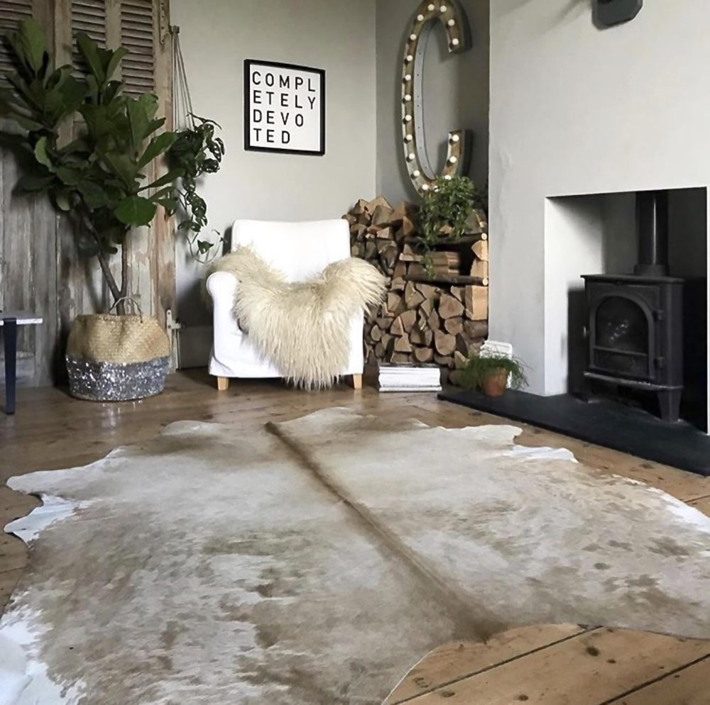 Beautiful beige cowhide rug from 'Nordic Hides and Skins' as seen in the beautiful home of Dee Campling find her on instagram at  @deecampling