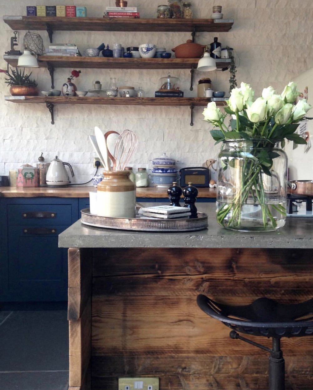 The reclaimed scaffold boards on the back of the Island add warmth and texture to the blue kitchen.....