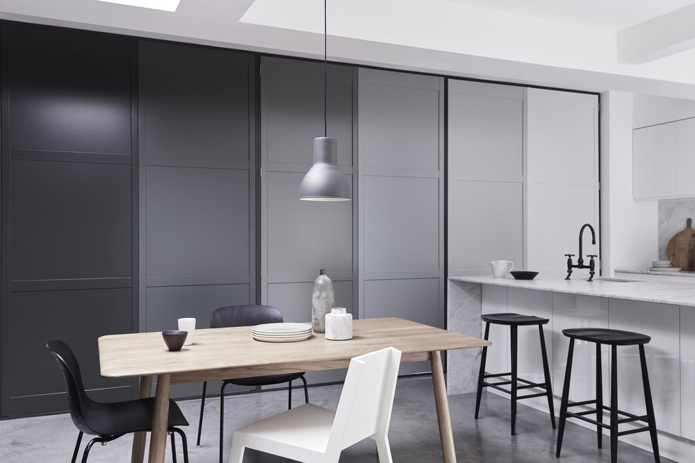 With the grey ombre tracked door shutters closed the bifold doors in this kitchen turn into a contemporary piece of art at night.....