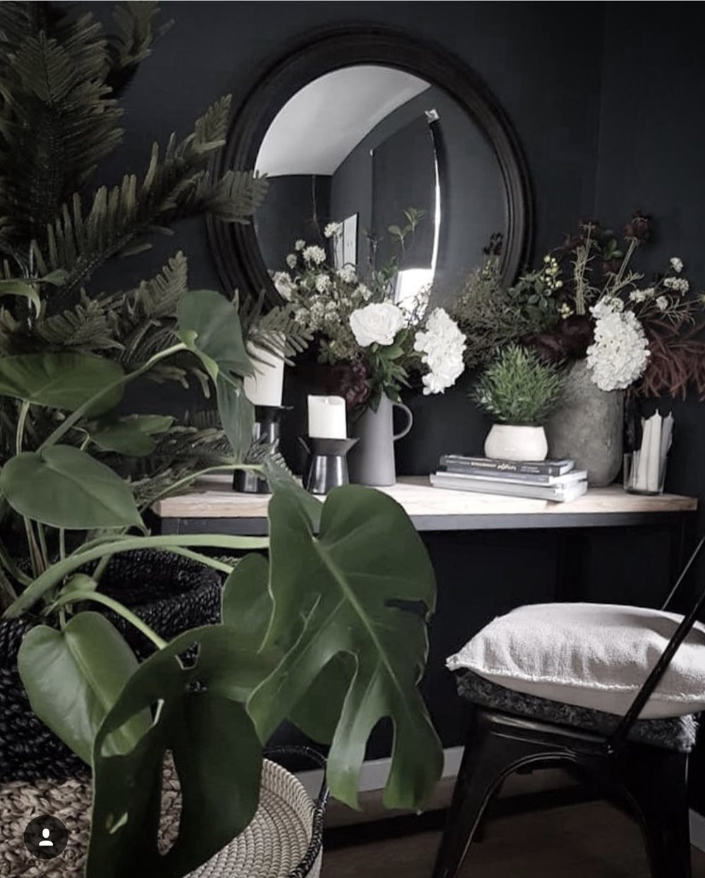 Black round convex mirror and console table  www.maisonsdumonde.com. .....faux flowers  www.abigailahern.com