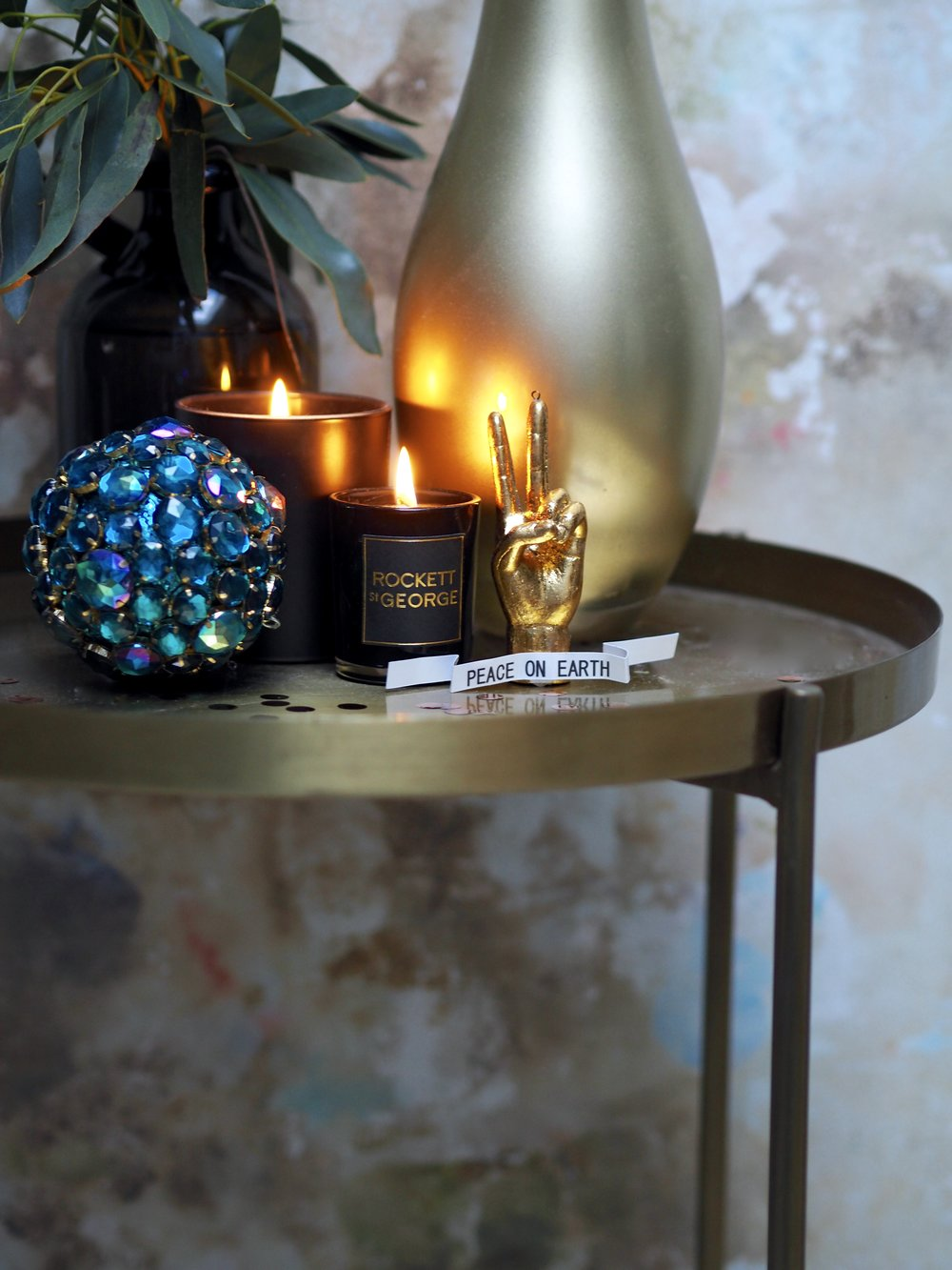 Such a cool decoration- I've popped it on the gold side table here as well as on the tree….    Peace On Earth Hand Decoration