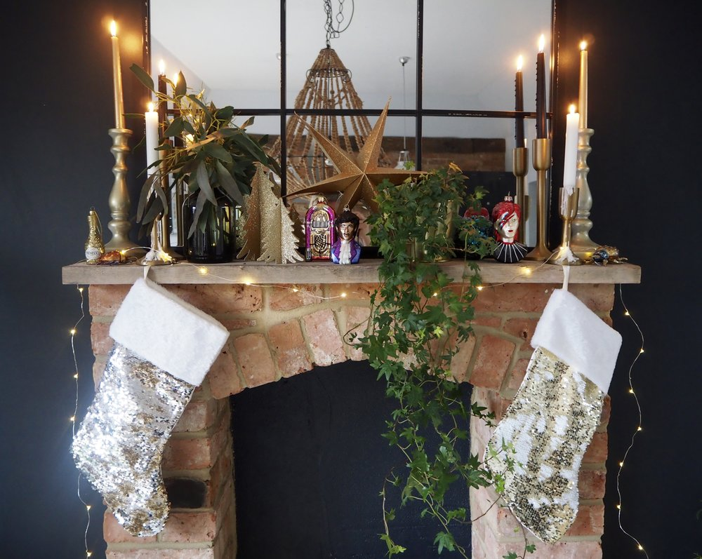 If you don't have room for a tree decorate your fireplace to the max with christmas ivy, candles, sequins, glitter, fairy lights and colourful decorations….   Ziggy Hanging Decoration