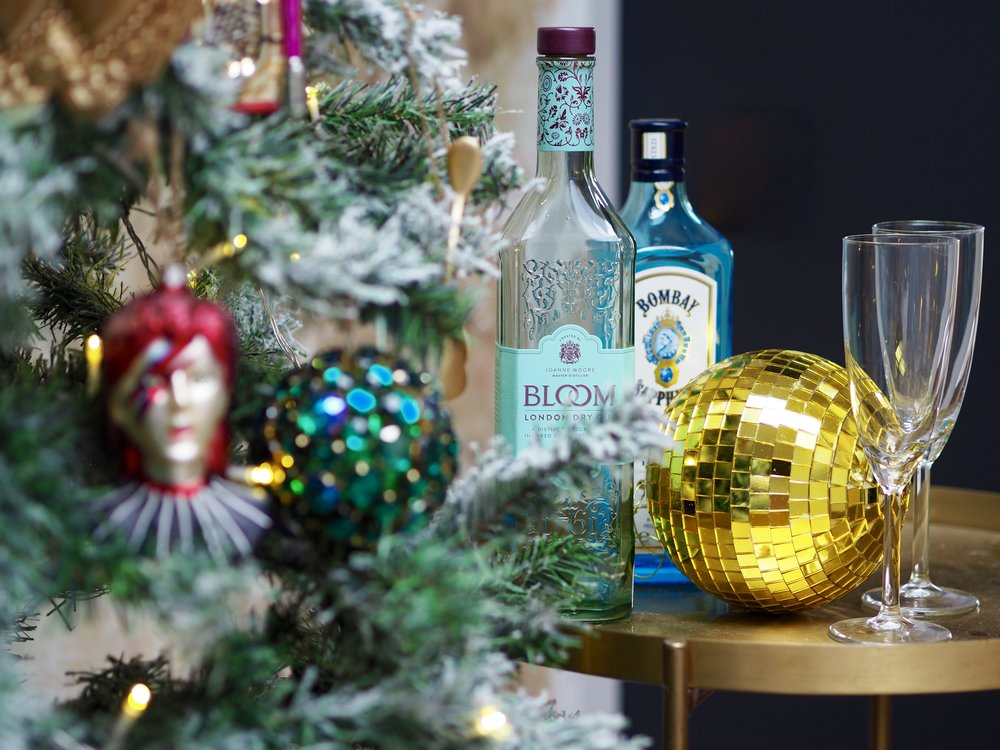 The small gold gold disco ball is just the right size to add a bit of glitz to the mini bar next to the tree……    Golden Disco Ball Decoration