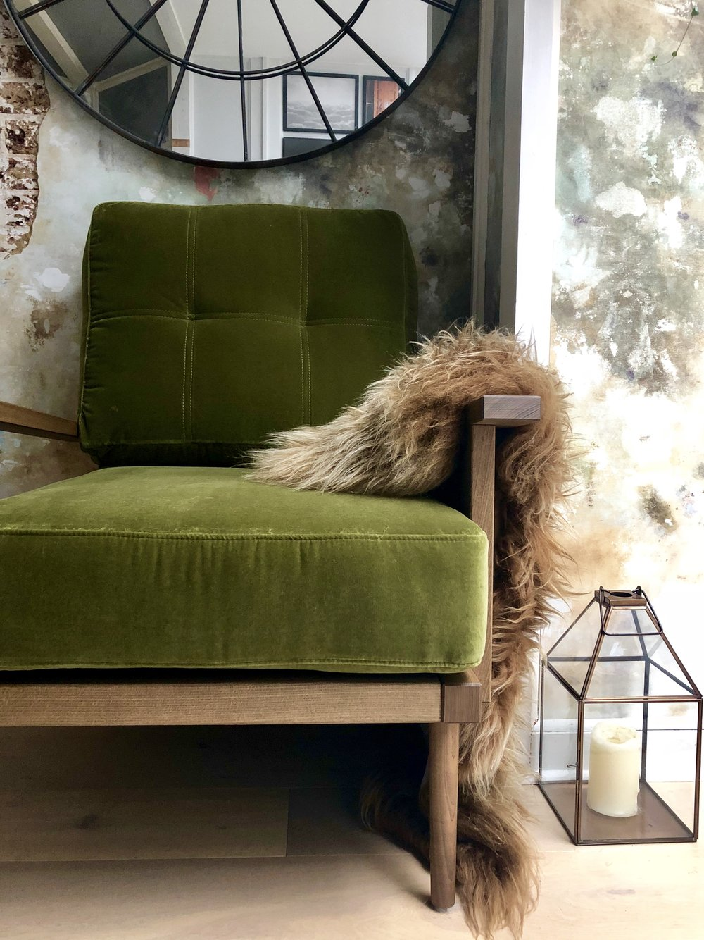 The texture and colour of this sheepskin rug work beautifully with the olive green and oak….