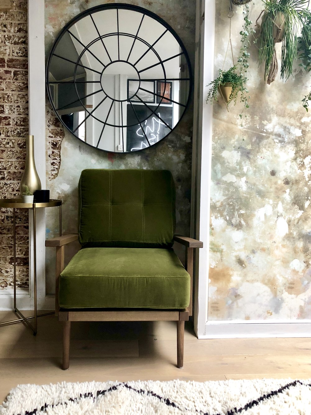 Olive green, brass and exposed brick- What a fab combination!