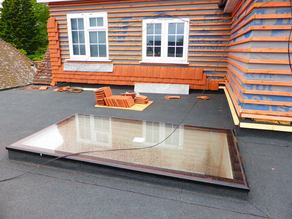 Once the rooflight was on the upstand the roofers came in to make it weather tight….