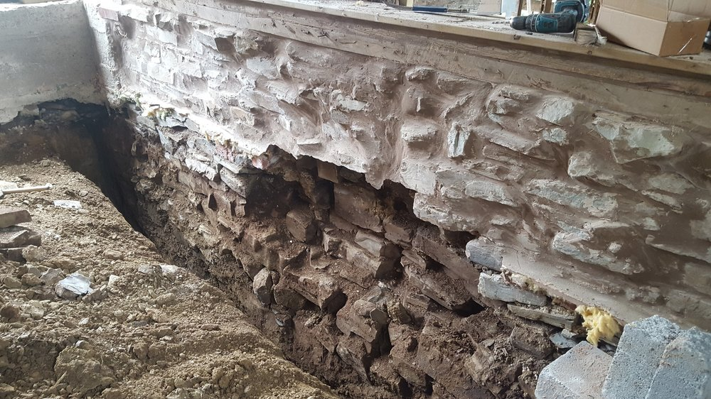 The original stone wall on one of the bedrooms - just before insulating