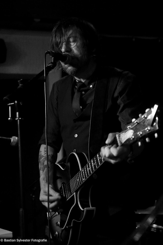 Alex with Guitar at Extra Blues Bar.jpg