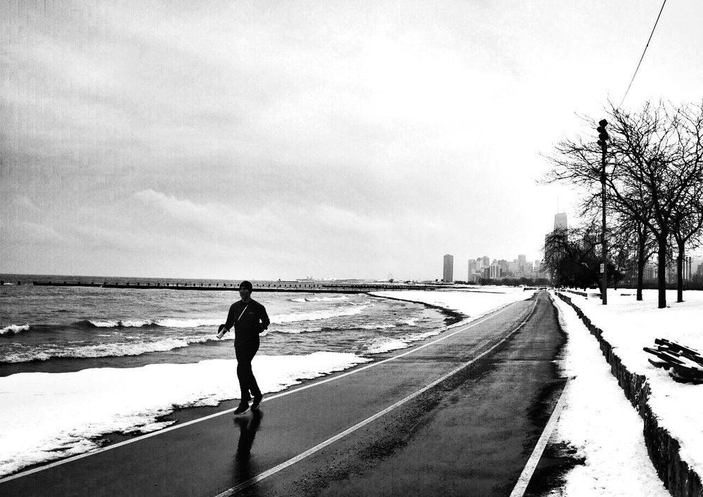 Jogger on lake front trail CHICAGO IL, Jan 2016