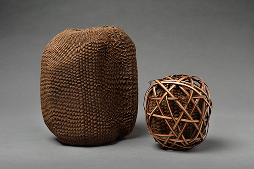 "Kaki Shibu, 2004Fiber: 8.5″ x 7″ x 5.5″ and 5″ x 5.25″ x 4″ - The themes of containment and secrecy have driven Nancy Bess's work for over 20 years. Inspired by the 1993 New York exhibition Secrecy: African Art that Conceals and Reveals, Bess says, ""I use lids and closures to imply that, though there is something inside my vessels, we aren't allowed access to that space and those mysterious contents."" In addition to a strong African influence, she counts Japanese, Asian Indian, and Californian colors and motifs among the inspirations for her work."