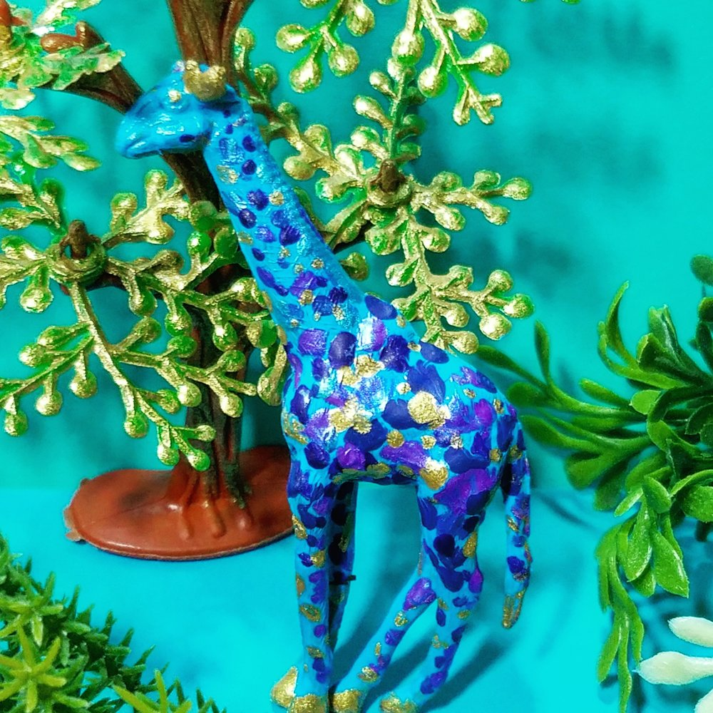 Blue giraffes eat only gold paint.