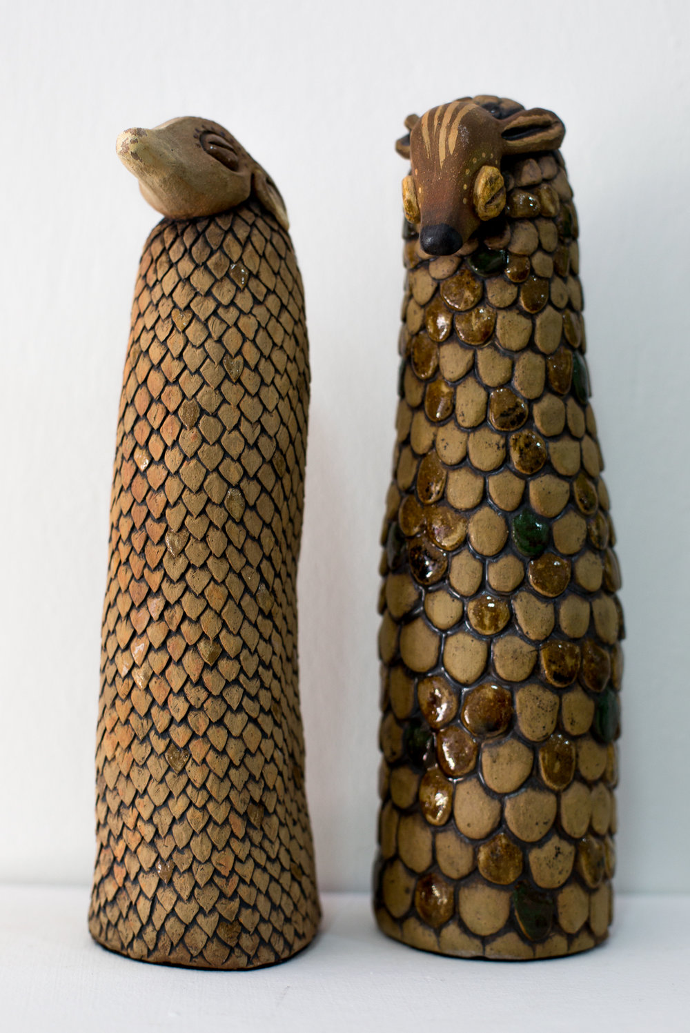 ' Sentential ' (Left)   Alexis Aronson  Ceramic and metal oxides  270 mm tall  R 5000.00 excl. vat  &' Friends of Oaks' (Right)  Alexis Aronson  Ceramic and metal oxides  280 mm tall  R 5000.00 excl. vat