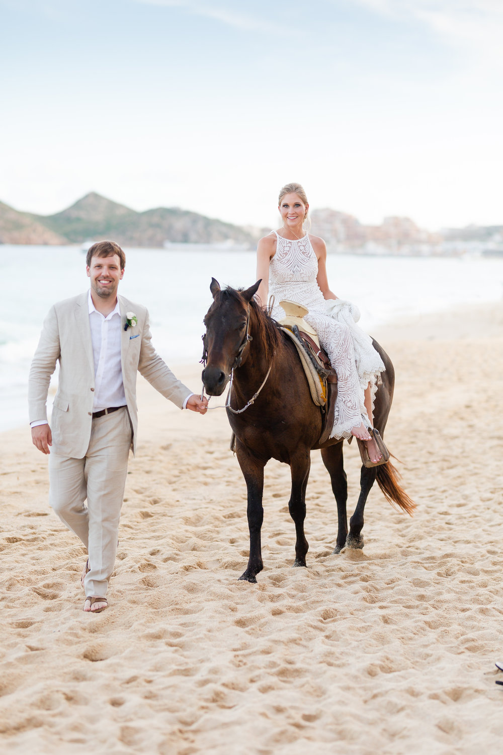 Meet Ashley - There are four things I love in life; my husband, photography, traveling, and horses. If I can incorporate all four, my heart is full.My couples are adventurous and full of love and passion. I strive to document their unique love story and create memories that will last a life time.