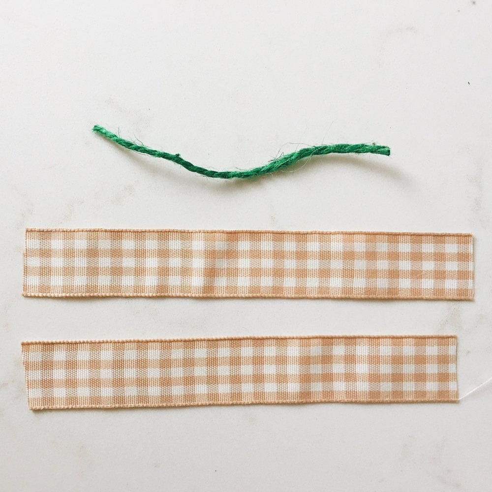 step 2: - Cut twine and ribbon into 2 inch pieces.