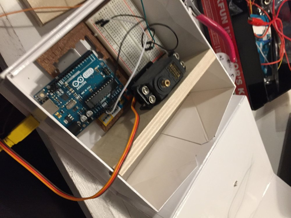 I then added the Arduino to control the servo and breadboard in the box.  I also drilled a hole to insert the USB cable to power the Arduino