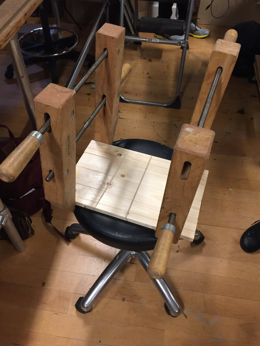 I glued the top of the table using wood glue, rubber bands, and these large wooden clamps and I let it sit overnight.