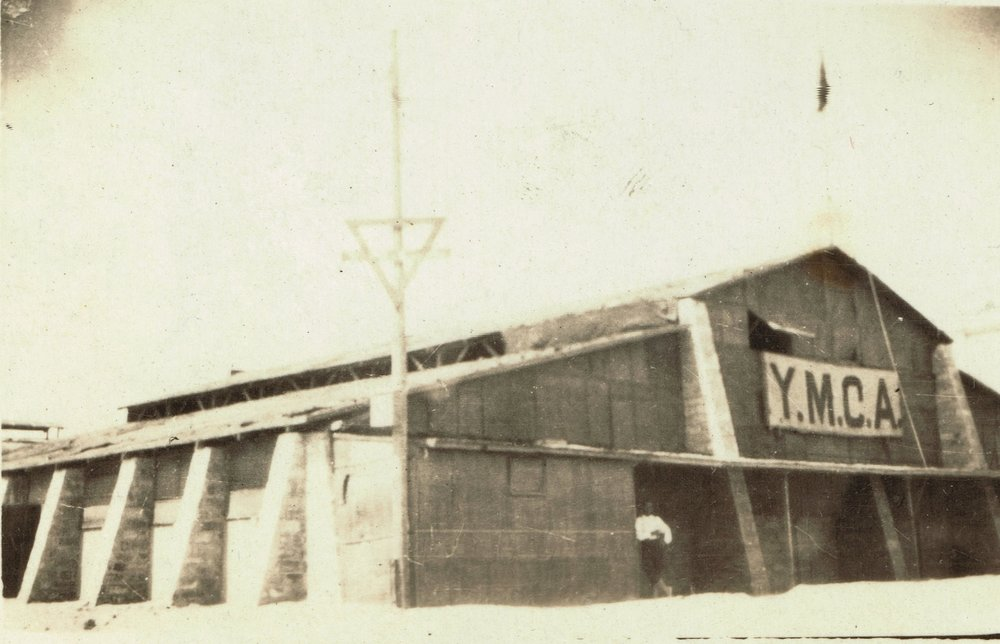 "The YMCA at Port Said Rest Camp. ""The chap is leaning against my office."""
