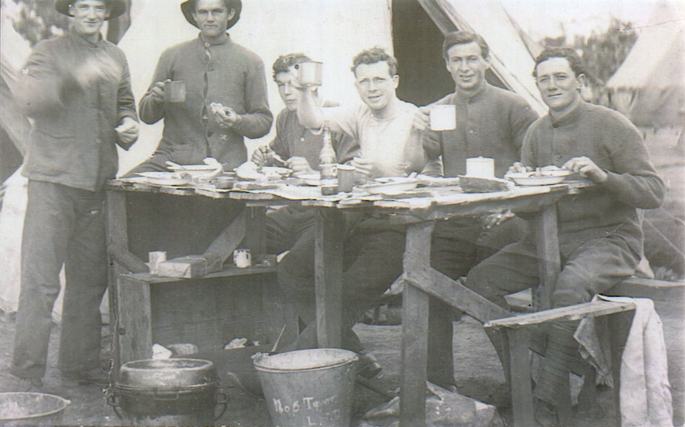 Reg (mug raised) in training with Light Horse Regiment, November 1915.