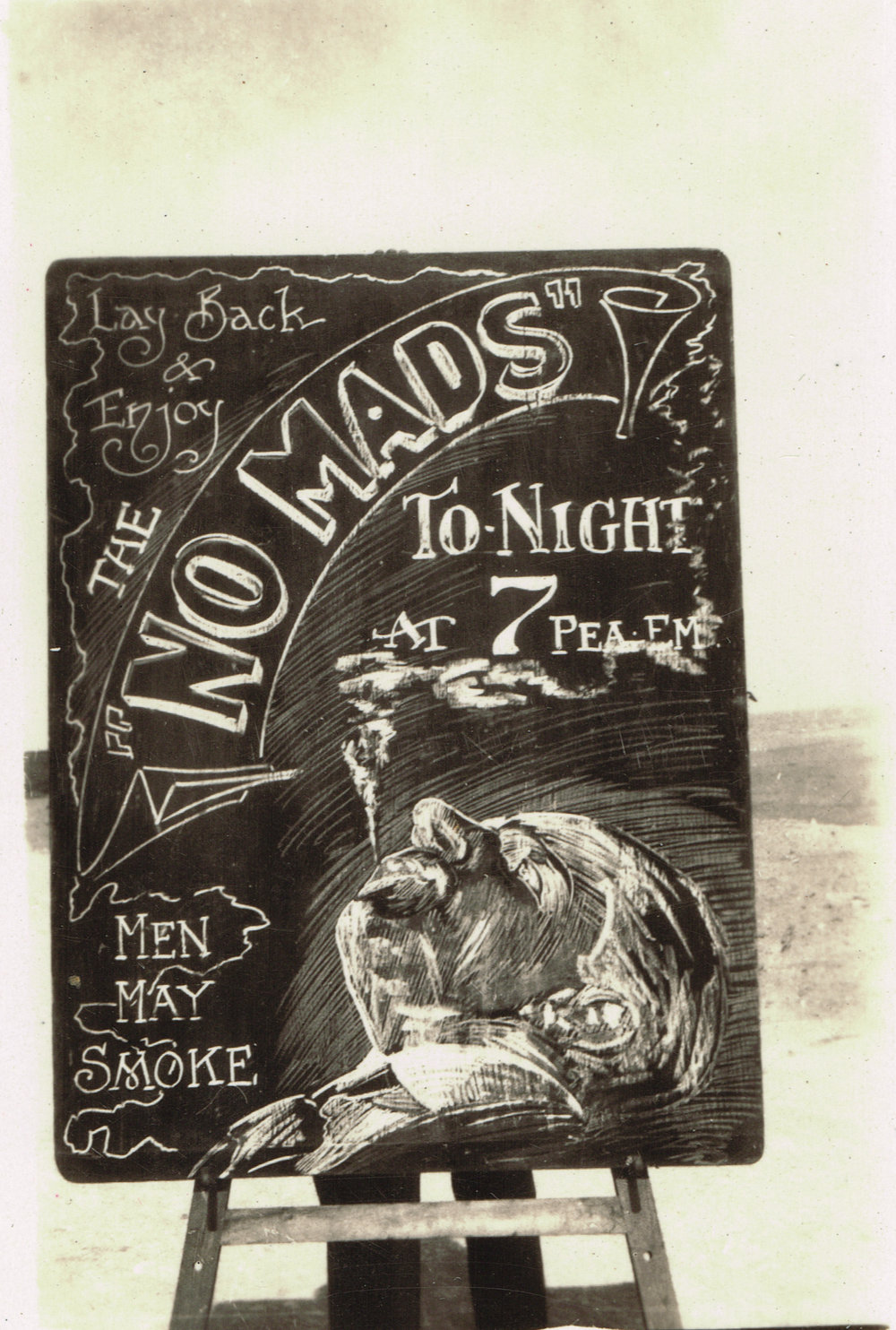 "Reg's chalkboard advertising The Nomads tonight, ""at 7 pea em"" at Port Said Rest Camp in early 1916 or December to April 1919."