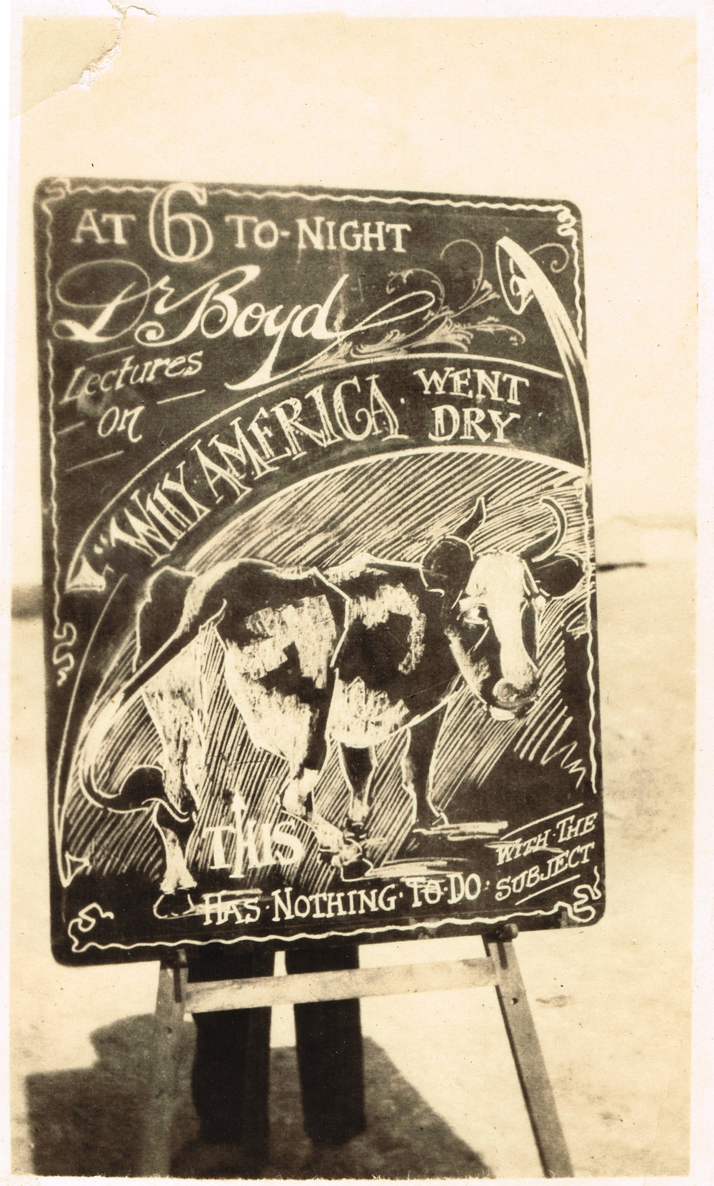 "Reg's chalkboard advertising Dr Boyd's lecture on Why America Went Dry. The whimsical cows, Reg says, have ""nothing to do with the subject""."