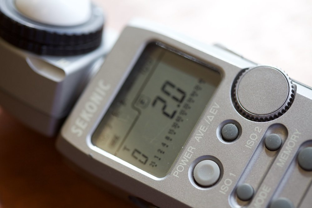 The meter I use most often reads flash as well as ambient light and can give readout in EV.