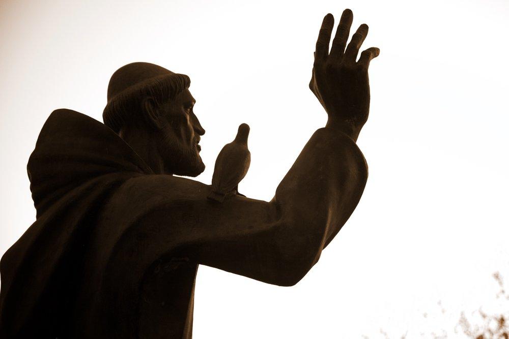 Saint Francis salutes the setting sun.