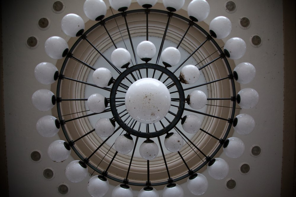 The chandelier in the center of the Muny Colonnade.