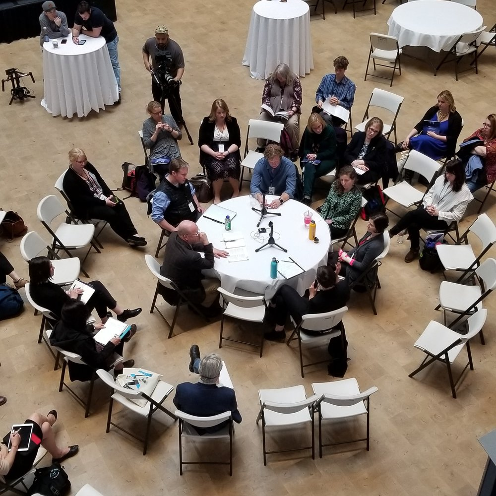 "Panelists and participants in the North by North Festival gather in the Anchorage Museum atrium for a group ""fishbowl"" conversation."