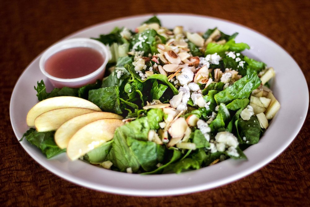 Apple Almond SaladFresh cut romaine and apples, blue cheese crumbles and sliced almonds with our homemade sweet onion vinaigrette dressing. - Individual- $5.95 Family- $8.95