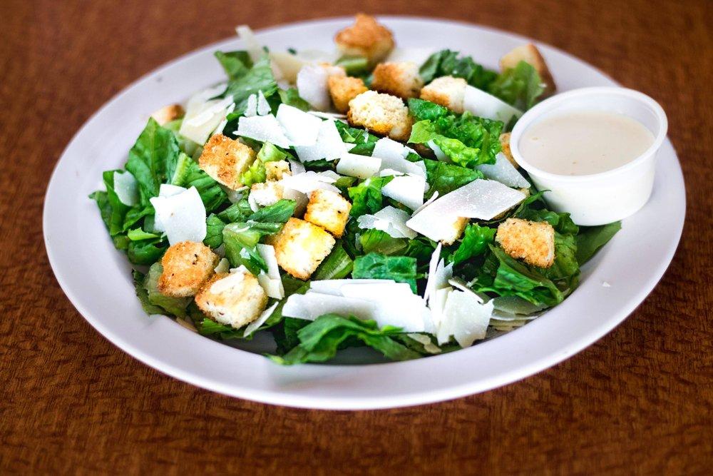 Caesar SaladFresh cut romaine,shaved parmesan and homemade croutons and caesar dressing. - Individual- $4.95 Family- $7.95