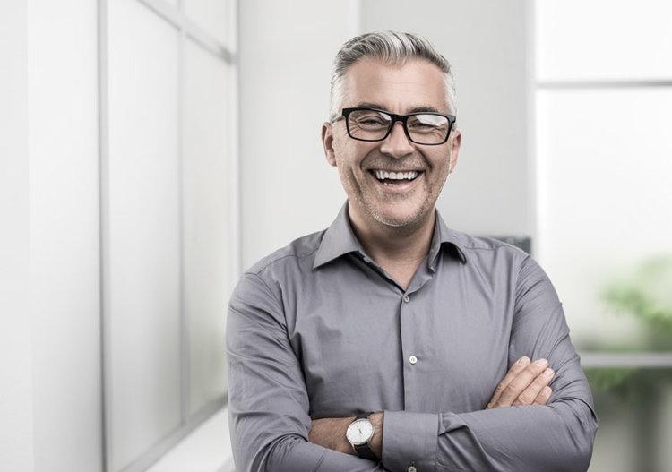 Older man smiling and enjoying good dental health