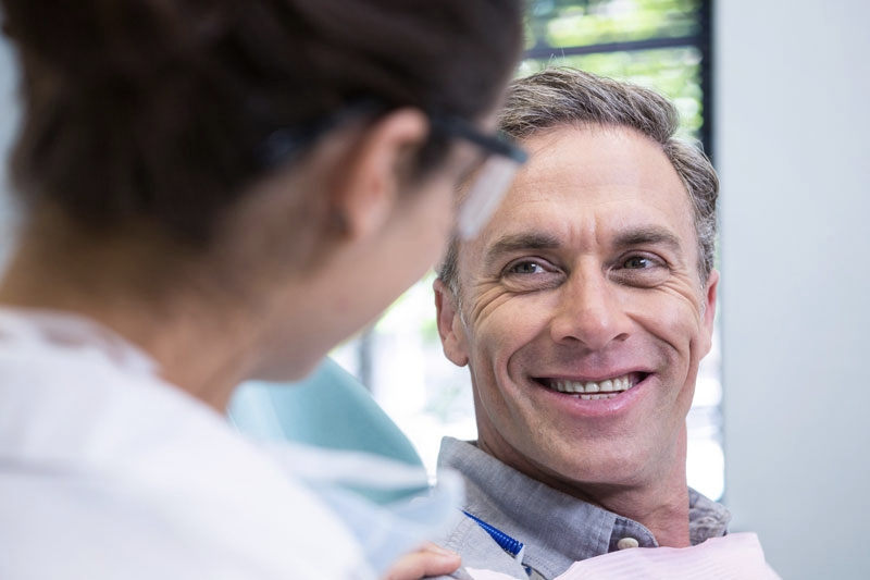 Handsome middle aged man at the dentist after dental emergency