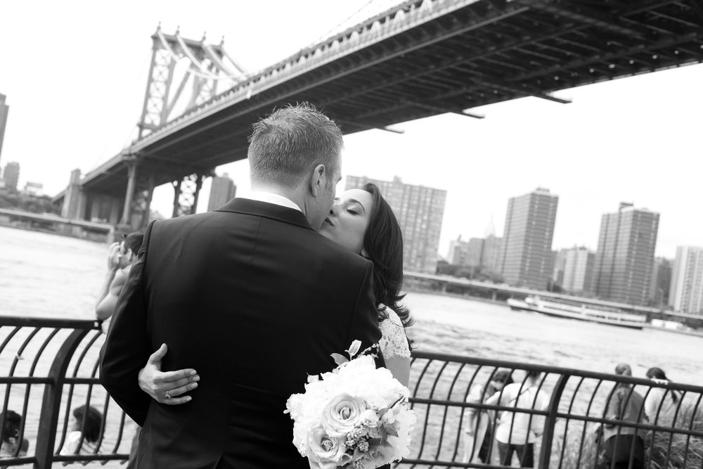 Beautiful Couple under the Manhattan Bridget in the DUMBO neighborhood of Brooklyn New York City.  Tania del Carmen is Richmond Virginia best wedding photographer.