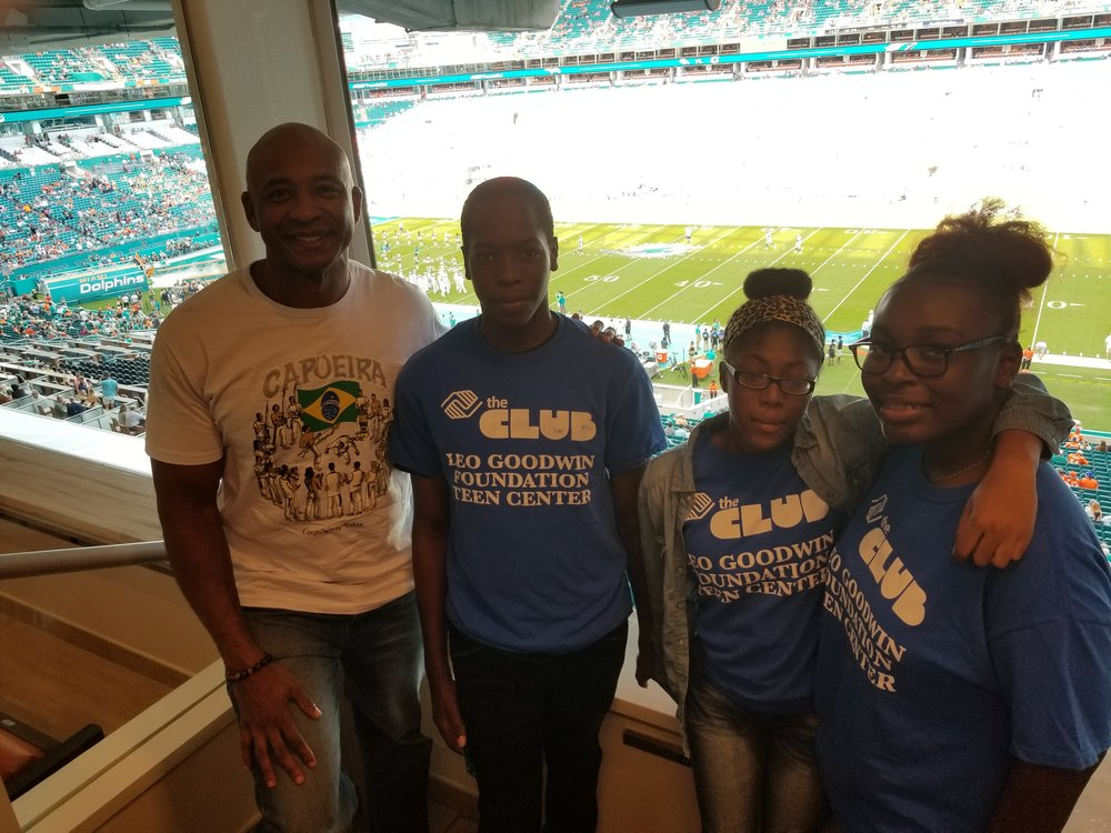 THE PILGRAM GROUP & BOYS AND GIRLS CLUB OF BROWARD COUNTY - The Pilgram Group treated three high-school students from the Boys & Girls Club to the Dolphins Game in his private suite. The students were chosen because they assisted in collecting donations for the Virgin Islands. With the help of these students 40 boxes were packed and shipped to the Virgin Islands.