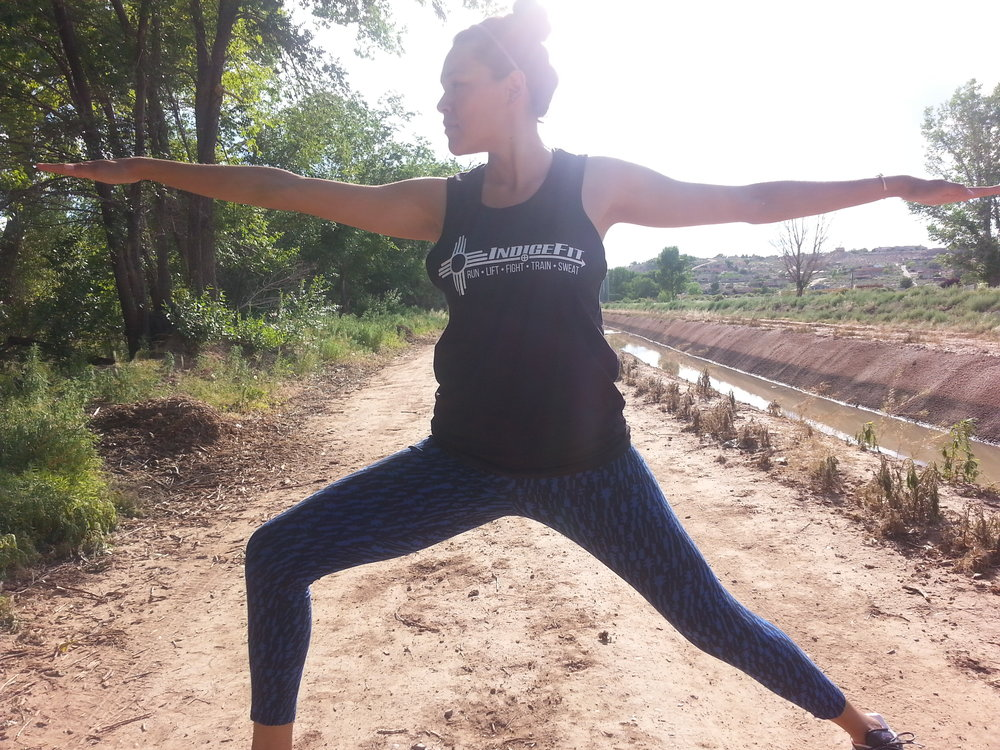 Christine Means doing yoga along the bosque in Albuquerque, NM