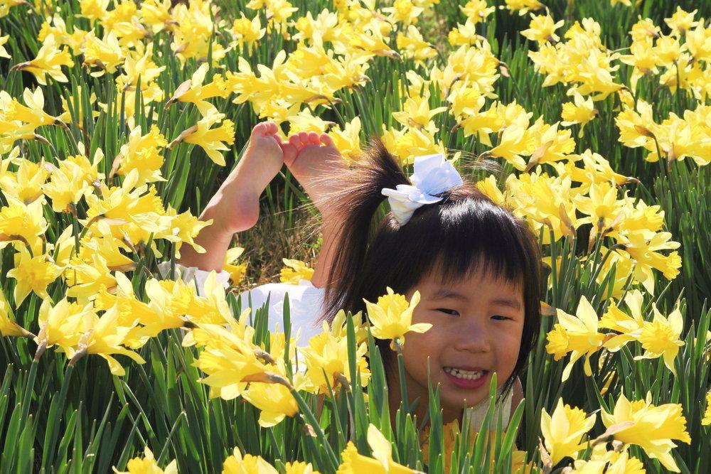 maria in flowers.JPG