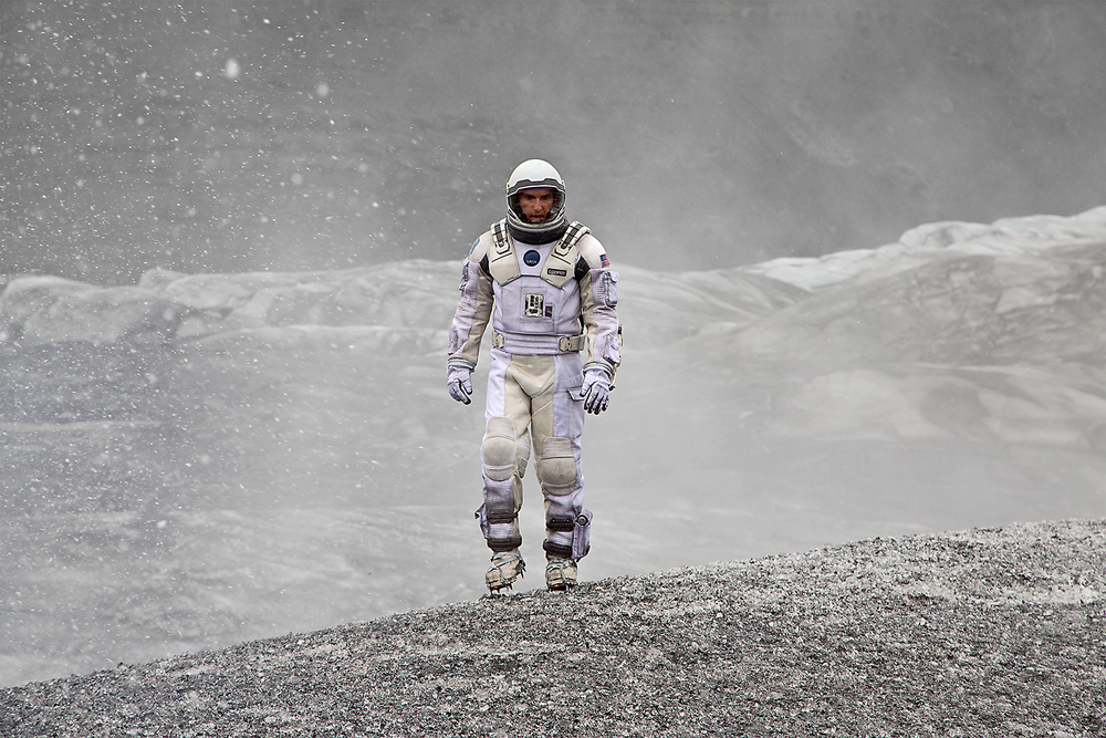 Coop (Matthew McConaughey) wanders the frozen-cloud surface of the planet Mann