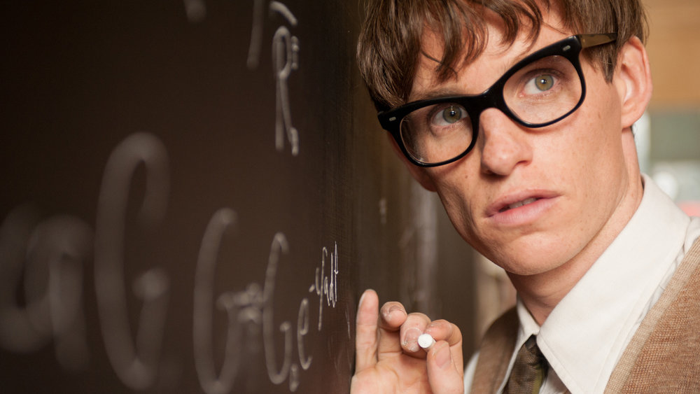 Stephen Hawking (Eddie Redmayne) works to prove that the size and shape of a rotating black hole depends on its mass and rate of rotation