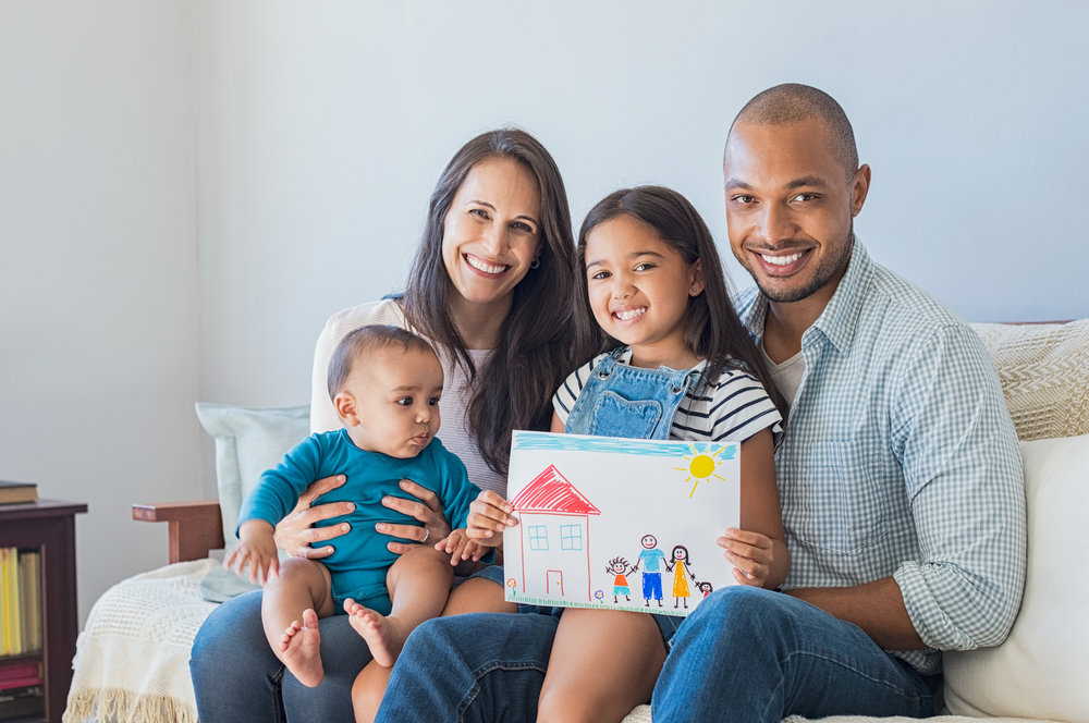 Family with child's drawing iStock-696311458.jpg