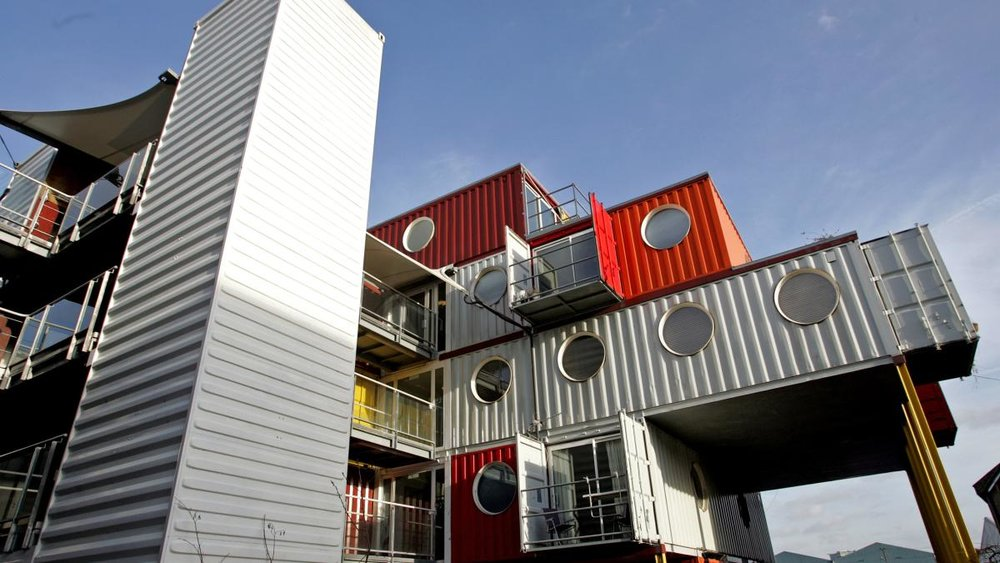 """""""Shipping containers have been turned into homes and workspaces in London's Docklands.""""  PAUL ROGERS"""